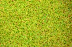 Textuur van een gekleurd korrelig zand dicht omhoog Gele korrels stock fotografie