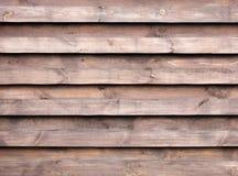 Textuur van een houten omheining met een nieuwe horizontale bruine achtergrond Stock Foto's