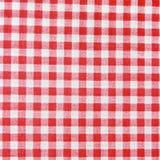 Textuur van een rode en witte geruite picknickdeken. stock foto