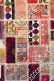 Textuur van een stuk van oud tapijt stock foto's