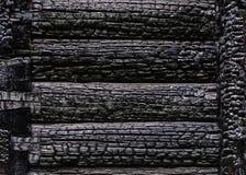 Textuur van gebrande houten muurachtergrond stock foto's