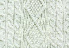 Textuur van gebreide met de hand gemaakt Dichte omhooggaand van de Kerstmis witte sweater Behang, abstracte achtergrond Royalty-vrije Stock Foto