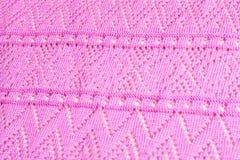 Textuur van gebreide roze stof stock fotografie