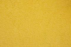 Textuur van gele concrete muur stock foto's