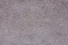 Textuur van geschilderde korrelige grijsachtige roze muur royalty-vrije stock afbeeldingen