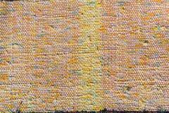 Textuur van geweven katoenen rode, roze, witte, gele draden Royalty-vrije Stock Foto's
