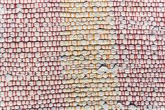 Textuur van geweven katoenen witte, oranje, rode draad Royalty-vrije Stock Afbeelding