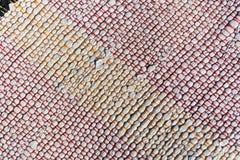 Textuur van geweven katoenen witte, oranje, rode draad Stock Afbeeldingen