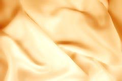 Textuur van gouden zijde Stock Afbeeldingen