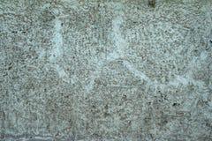 Textuur van grijze cementmuur met hulp Stock Afbeeldingen