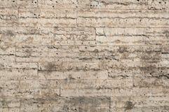 Textuur van grijze muren van poreuze steen Stock Afbeeldingen