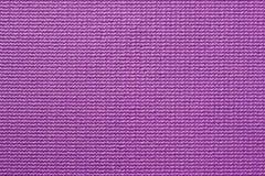 Textuur van het patroonachtergrond van de tapijt purpere kleur Stock Foto