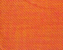 Textuur van multikleurenstof met regelmatig die patroon als achtergrond wordt gebruikt Stock Afbeeldingen