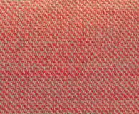 Textuur van multikleurenstof met regelmatig die patroon als achtergrond wordt gebruikt Stock Foto's