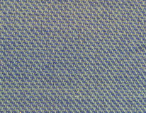 Textuur van multikleurenstof met regelmatig die patroon als achtergrond wordt gebruikt Stock Foto