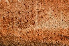 Textuur van muur met rood lood wordt geschilderd dat Stock Foto's