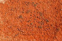 Textuur van muur met rood lood wordt geschilderd dat Stock Afbeelding
