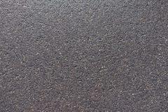 Textuur van natte onbeschadigde asfaltgrond stock foto