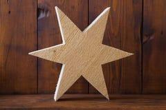 Textuur van onbehandelde houten met de hand gemaakte ster voor Kerstmis Stock Afbeelding