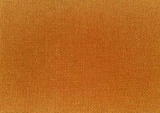 Textuur van oranje stof Royalty-vrije Stock Afbeeldingen