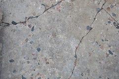 Textuur van oud beton Barsten en schade Grijze concrete achtergrond stock afbeeldingen