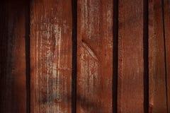 Textuur van oud hout met gebarsten verf van rode kleur stock foto's