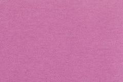Textuur van oude donkere roze document close-up Structuur van een dicht karton De roze achtergrond Royalty-vrije Stock Fotografie