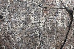 Textuur van oude steenplak met barsten Schaduwen van Grijs royalty-vrije stock foto