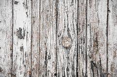 Textuur van oude witte verf op zwarte raad Stock Foto's