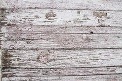 Textuur van oude witte verf op zwarte raad Stock Foto