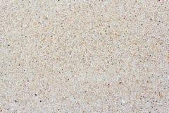 Textuur van overzees zand om de achtergrond tot stand te brengen Stock Afbeeldingen