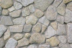 Textuur van overzeese steen met een laag bedekte muur Stock Afbeelding