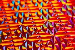 Textuur van rode folie met holografisch effect De achtergrond van Kerstmis royalty-vrije stock afbeeldingen