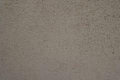 Textuur van stoffige beige geschilderde muur royalty-vrije stock foto's