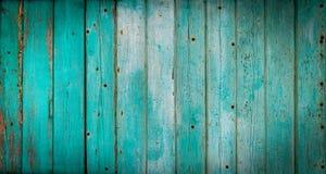Textuur van verticale houten planken met schil turkooise blauwe mede Stock Fotografie