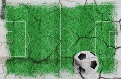 Textuur van voetbalgebied met bal Stock Fotografie