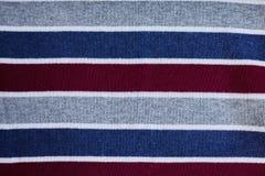 Textuur van warme gebreide gestreepte kleren royalty-vrije stock afbeelding