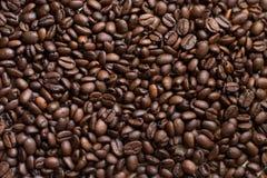 Textuur van willekeurig verspreide koffiebonen Bruine Textuur royalty-vrije stock foto's