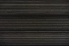 Textuur van zwarte terrasvormige raad Achtergrond van het decking royalty-vrije stock foto