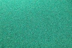 Textuurachtergrond van de groene plastic deurmat Royalty-vrije Stock Afbeeldingen
