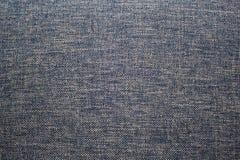 Textuurachtergrond van grijze stof, textiel, een deel van kleren, stock foto's