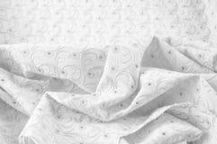 Textuurachtergrond van stof Doek met geslagen cirkels wit Stock Foto
