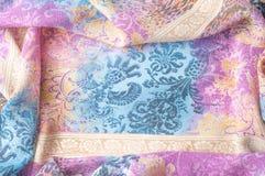 Textuurachtergrond, zijdestof, met abstract patroon Bl Stock Foto