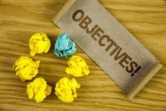 Textzeichen, das Zielen Motivanruf zeigt Begriffsfoto Ziele planten erzielt zu werden wünschten die Ziele, die auf gefalteten Ca  lizenzfreies stockbild