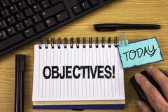 Textzeichen, das Zielen Motivanruf zeigt Begriffsfoto Ziele planten erzielt zu werden wünschten die Ziele, die auf Notizblock O g lizenzfreie stockbilder