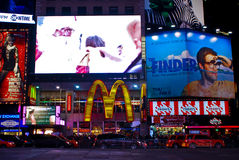 TGI Fridays and McDonald's Times Square, NYC. Times Square NYC featuring the video screens and billboards above the McDonald's and TGI Fridays restaurants Royalty Free Stock Photo