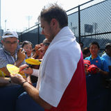 TGrand Slam champion Stanislas Wawrinka of Switzerland signs autographs after practice for US Open 2016 Stock Photos