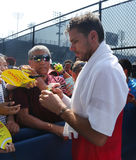 TGrand Slam champion Stanislas Wawrinka of Switzerland signs autographs after practice for US Open 2016 Royalty Free Stock Image