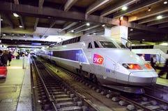 TGV train stands on Montparnasse railway station. Stock Photos