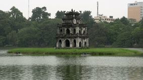 Tháp Rùa (Turtle Tower) in Hoàn Kiếm Lake stock footage